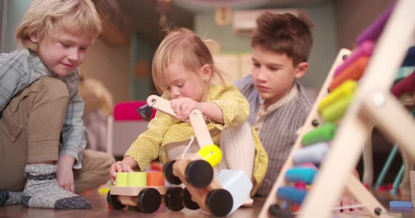 Young brother clapping hands and sister playing with toy truck in their bedroom Royalty-free stock video