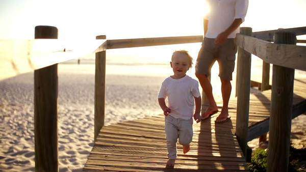 Father and son running on jetty Royalty-free stock video