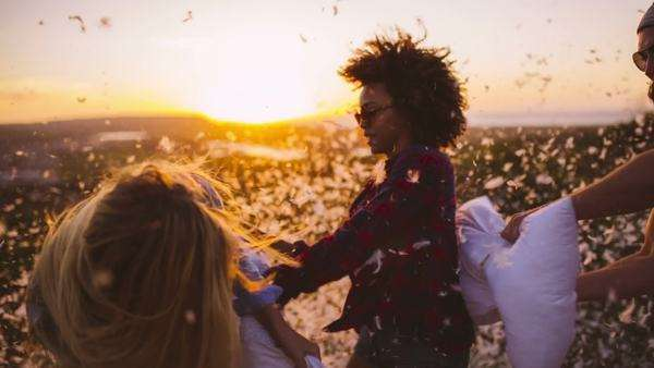 Friends having Pillow fight at sunset Royalty-free stock video