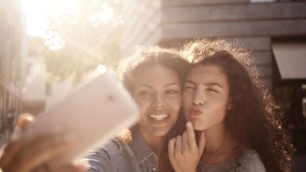 Mixed race Friends taking selfie with a smart phone and making faces and fun Royalty-free stock video