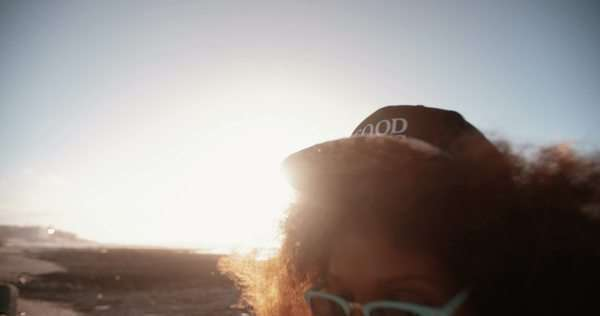 Trendy teenage hipster at the beach wearing a cool cap in slow motion Royalty-free stock video