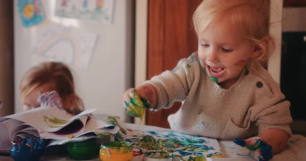 Happy Little Toddlers Finger Painting In Family House Kitchen Royalty Free Stock Video