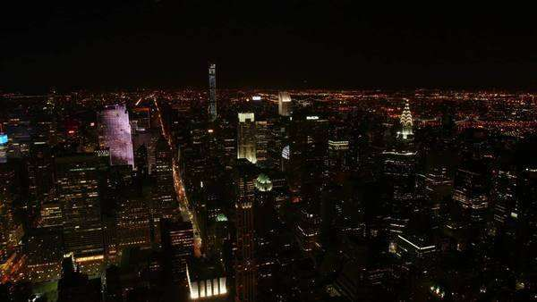 Timelapse in New York at night showing the Chrysler Building, glow of Times Square and car lights moving Royalty-free stock video