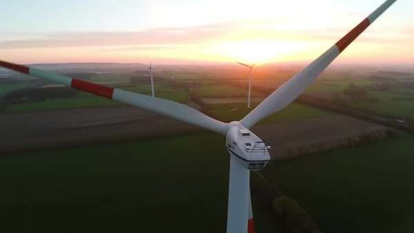 Muensterland, Germany - 20 April 2015, Wind turbines at sunset producing renewable energy Royalty-free stock video