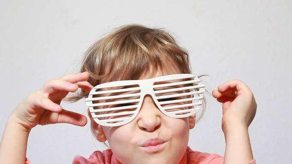 46ab313f56 Little girl play with white shutter shades glasses Royalty-free stock video