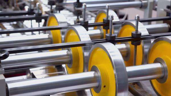 Several shafts and wheels spins in machine of printing conveyer Royalty-free stock video