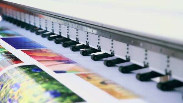Printing head creates colorful image on paper in machine Royalty-free stock video
