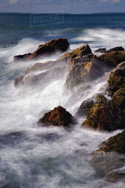 Long exposure of wave crashing against rocky coastline, Acadia National Park, Maine Royalty-free stock photo