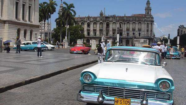 Classic American 50s Ford automobiles in view of busy streets of Havana Habana Cuba downtown by Capital Royalty-free stock video