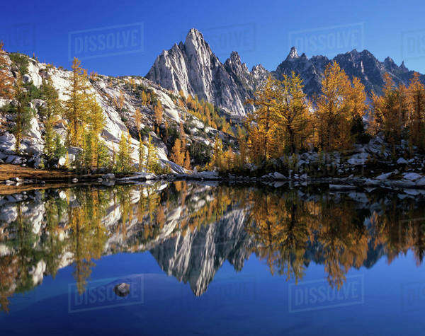WA, Alpine Lakes Wilderness, Enchantment Lakes, Prusik Peak and Temple Ridge, reflected in Sprite Lake Royalty-free stock photo