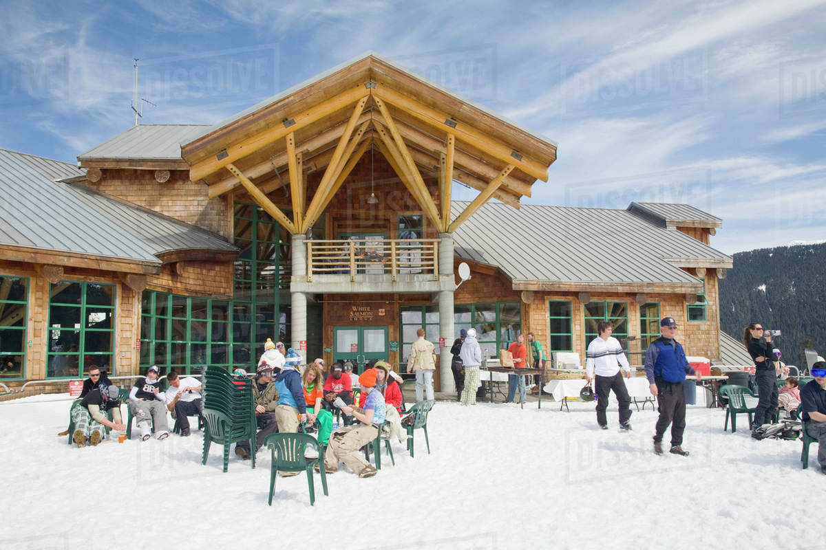WA, Mount Baker Ski Area, White Salmon Lodge, Snow Boarders And Skiers On  The Outdoor Patio
