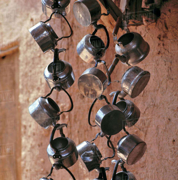 Afghanistan, Kholm. Metal teapots create a necklace of silver at a tea stall in the bazaar of Kholm, Afghanistan. Royalty-free stock photo