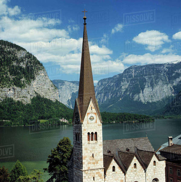 Europe, Austria, Hallstatt. The spire of this Hallstatt church can be seen for miles in the Salzkammergut, a World Heritage Site, Austria. Royalty-free stock photo