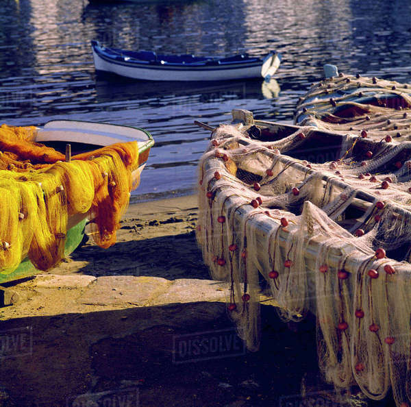 Europe, Greece, Mykonos. Nets draped over boats appear as fine-textured decoration in Mykonos, Greece. Royalty-free stock photo