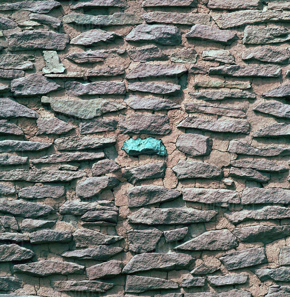 USA, Arizona, Wupatki Pueblo. A turquoise is embedded in the wall of a ruin in Wupatki and Sunset National Monument, Arizona. Royalty-free stock photo