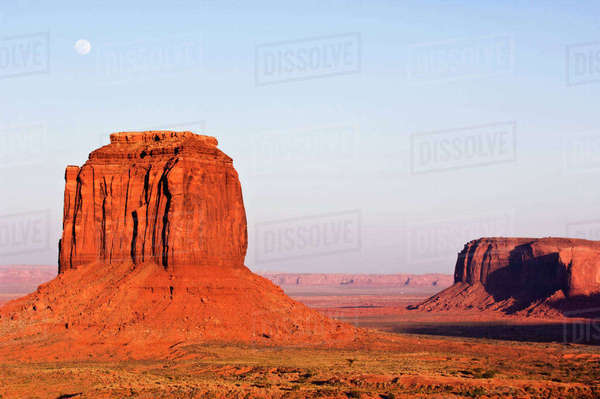 USA, AZ, Navajo Reservation, Full Moon Rising Over Merrick Butte in Monument ValleyTribal Park at Sunset Royalty-free stock photo
