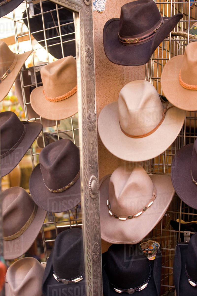 d6e7f7506 NA, USA, New Mexico, Santa Fe, Plaza, Cowboy Hats on Display Reflected in  Decorative Mirror stock photo