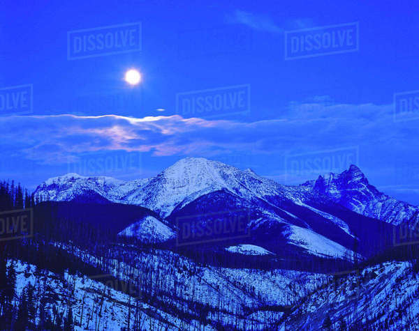 Full moonrise over the Cloudcroft Peaks in Glacier National Park in Montana Rights-managed stock photo