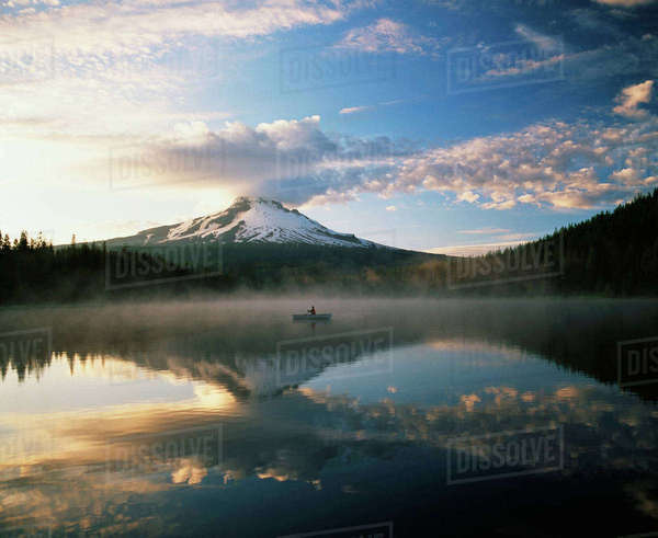 USA, Oregon, Mount Hood National Forest, Mount Hood Wilderness Area, Fisherman on Trillium lake with Mount Hood in background Rights-managed stock photo