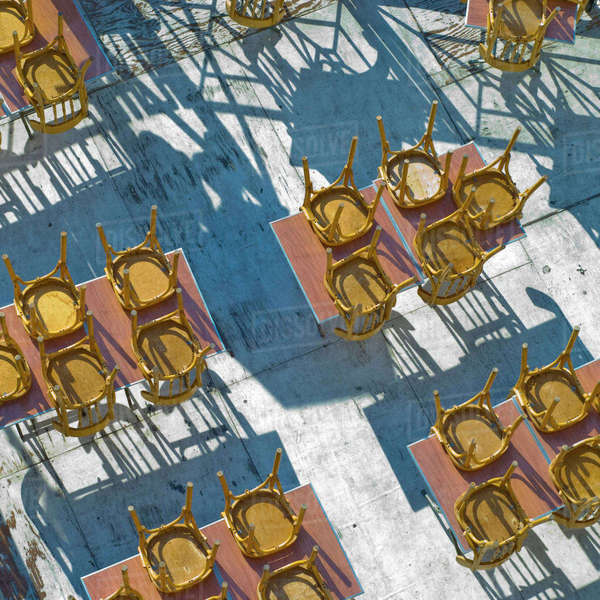 Cafe chairs in morning light on the Tiber River, Rome, Italy Rights-managed stock photo