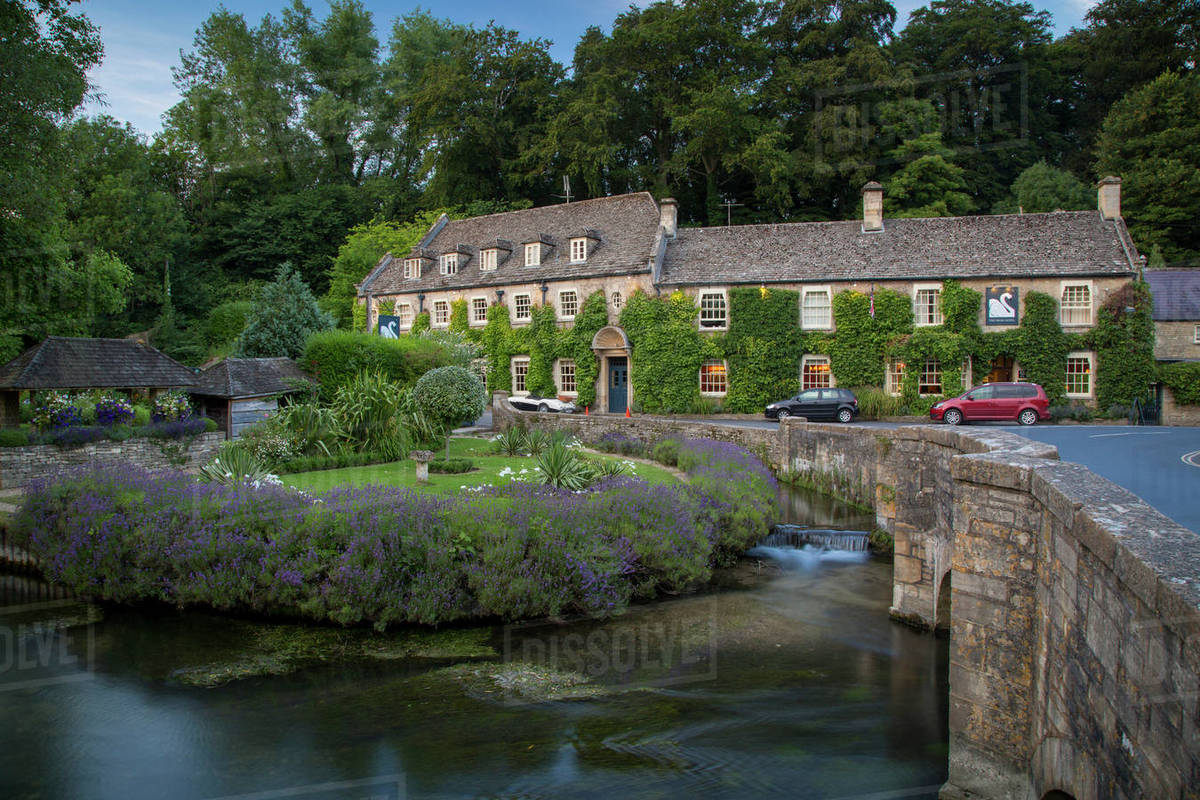 View Of River Coln And Swan Hotel The Cotswolds Bibury Gloucestershire England