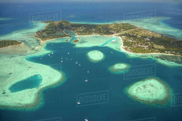 Coral reef and Musket Cove Island Resort (left), Plantation Island Resort (right), Malolo Lailai Island, Mamanuca Islands, Fiji, South Pacific, aerial Rights-managed stock photo