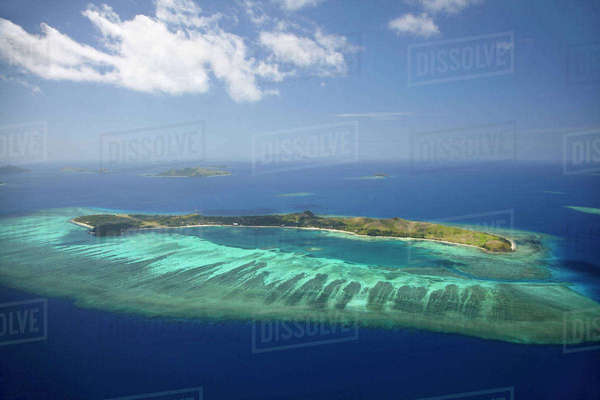 Mana Island and coral reef, Mamanuca Islands, Fiji, South Pacific, aerial Rights-managed stock photo