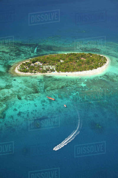 Treasure Island Resort and boat, Mamanuca Islands, Fiji, South Pacific, aerial Rights-managed stock photo