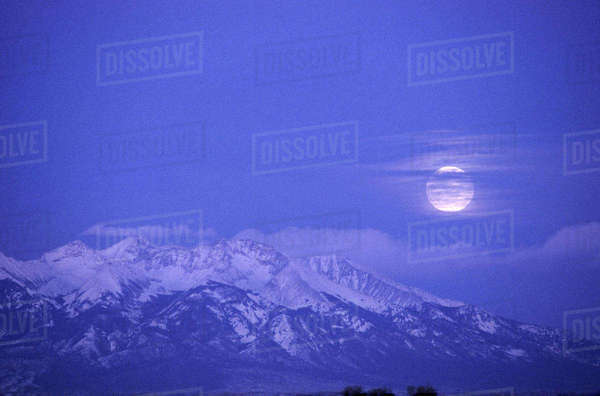 Moonrise over Sangre de Cristo Mtns. from Monte Vista NWR, CO Rights-managed stock photo