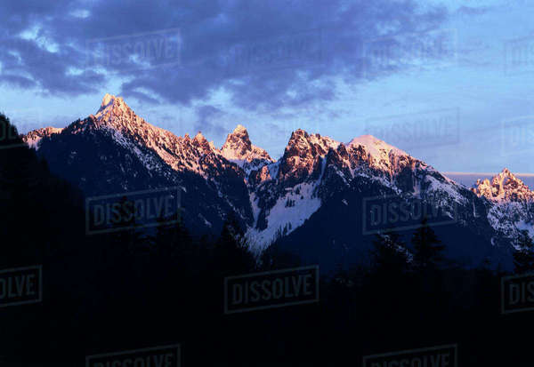 USA, Washington State, Mount Baker-Snoqualmie National Forest, View of Cascade Mountains at sunset Rights-managed stock photo