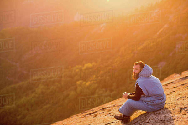 Man in sleeping bag on Moro Rock, Sequoia National Park, California, USA Royalty-free stock photo