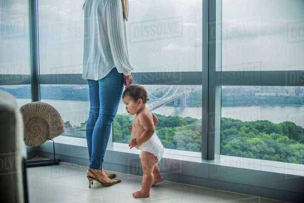 Mother and son at window overlooking bay Royalty-free stock photo