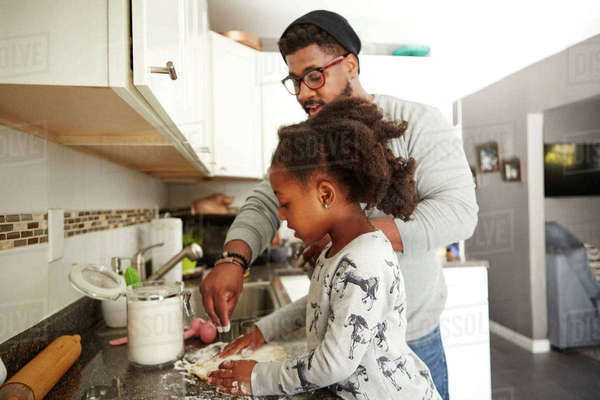 Father and daughter baking cookies together Royalty-free stock photo