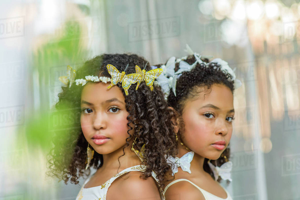 Portrait of two girls, wearing butterflies in hair Royalty-free stock photo