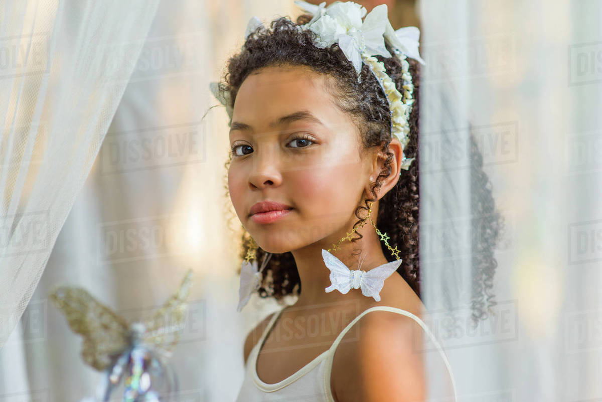 Portrait of young girl, dressed as fairy, wearing butterflies in hair Royalty-free stock photo