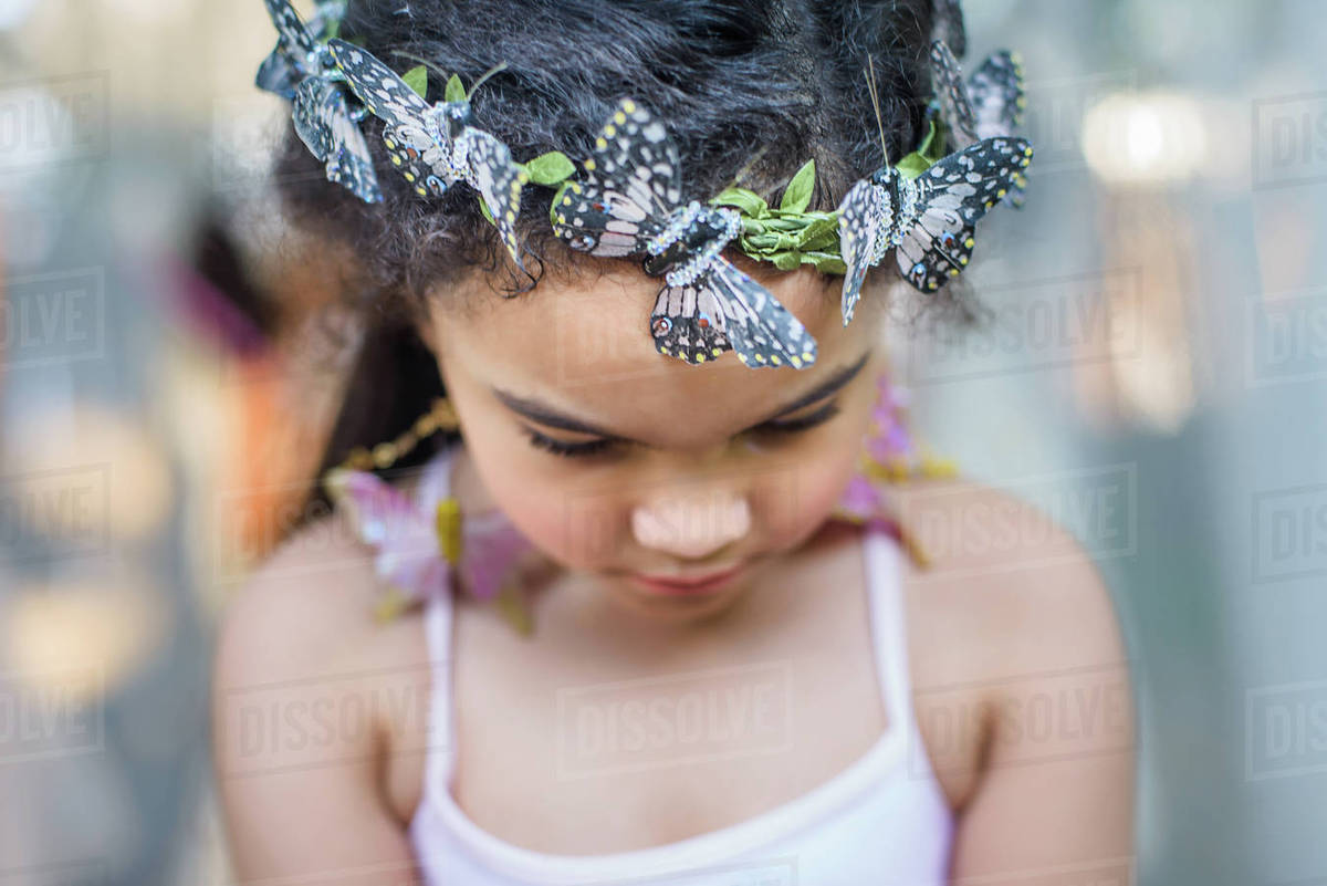 Portrait of young girl wearing butterflies in hair Royalty-free stock photo