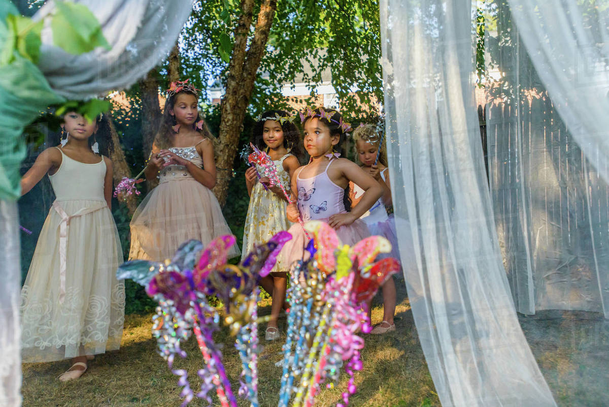 Group of young girls dressed as fairies, playing outdoors Royalty-free stock photo