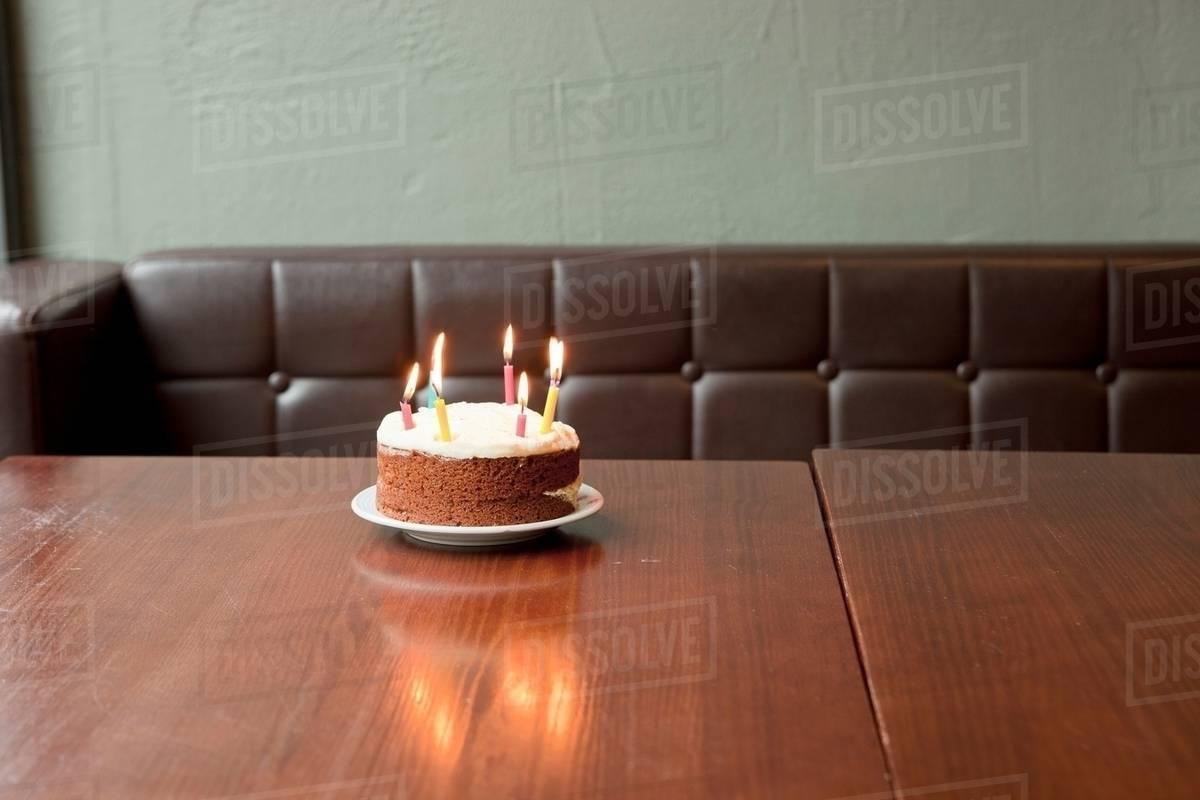 Birthday Cake On Table In Restaurant Stock Photo Dissolve