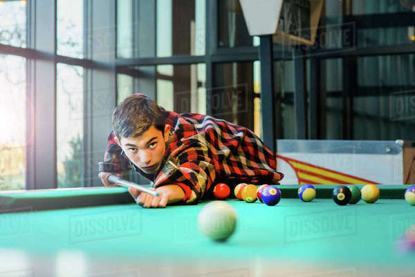 Teenage boy playing pool billiards Royalty-free stock photo