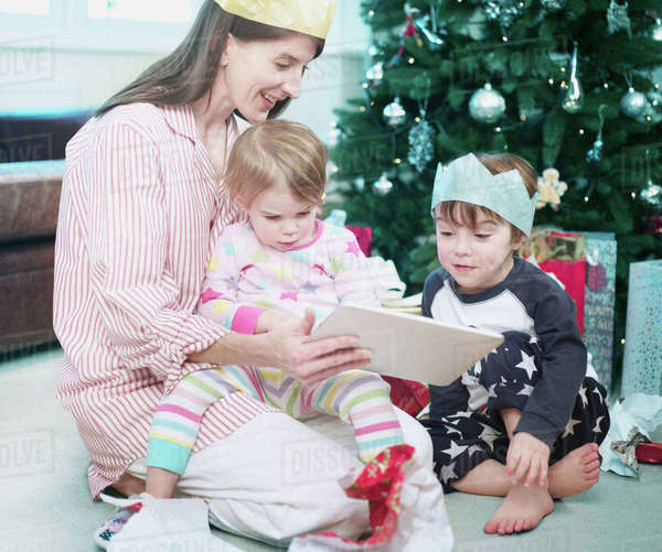 Mother with son and daughter opening christmas presents Royalty-free stock photo