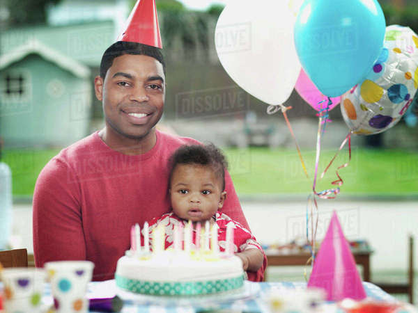 Father and baby boy at birthday party, portrait Royalty-free stock photo