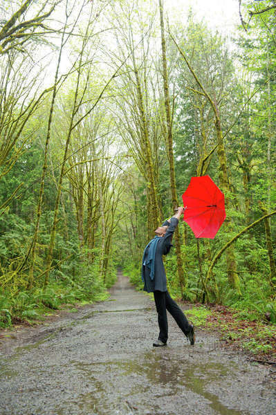 Woman on forest path with red umbrella Royalty-free stock photo