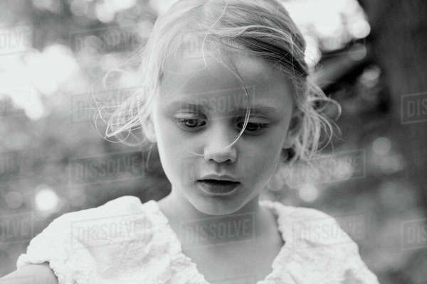 Little girl looking down Royalty-free stock photo