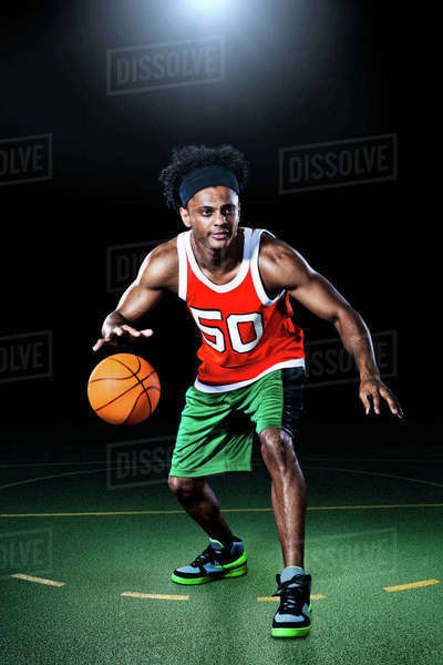 Basketball player bouncing ball Royalty-free stock photo