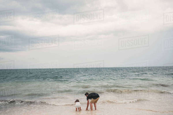 Father and daughter playing on beach, Cancun, Mexico Royalty-free stock photo