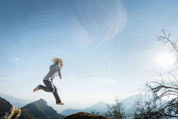 Boy jumping, blue sky in background, Sequoia National Park, California, US Royalty-free stock photo