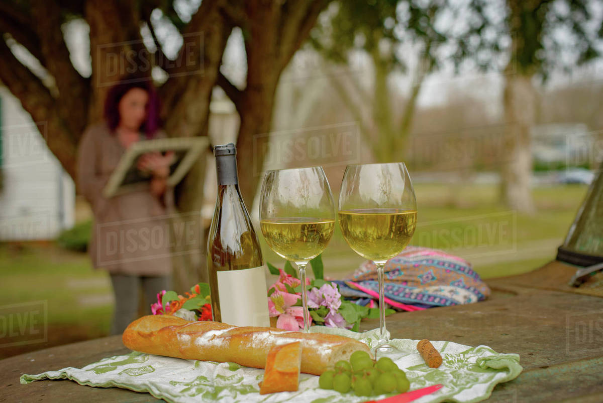 Woman relaxing with wine in garden - Stock Photo - Dissolve