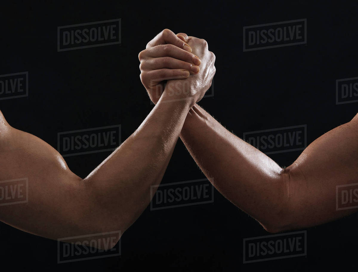 Arms Of Muscular Women Gripping Hands Stock Photo Dissolve
