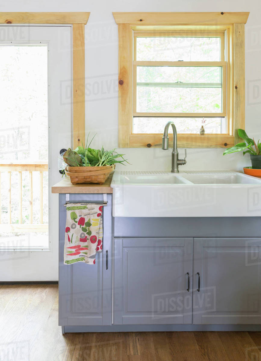 Butler sink in country kitchen - Stock Photo - Dissolve