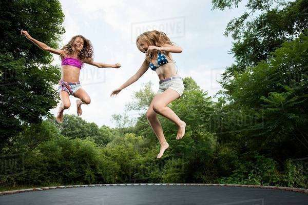 Two girls on trampoline Royalty-free stock photo